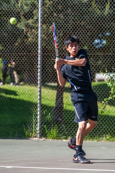 TRIBUNE PHOTO: DIEGO G. DIAZ - Freshman Miguel Diaz-DeLeon of Roosevelt High returns a shot in a Portland Interscholastic League home match last week against Franklin.