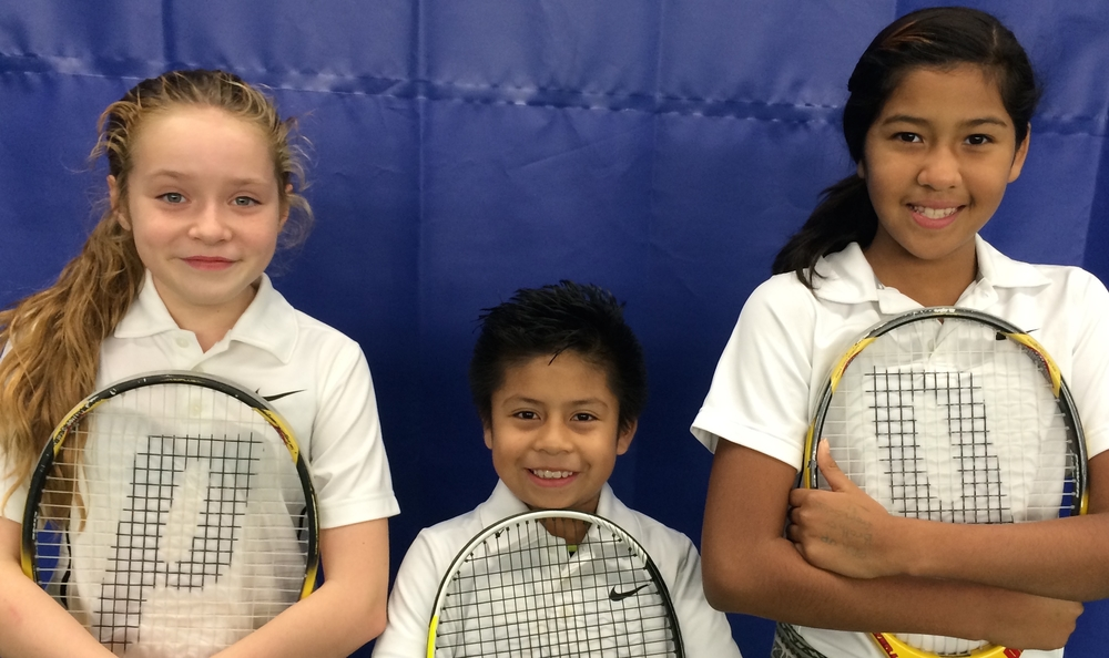 Marissa, Martin, and Ashley celebrate The Kids on the Court's final match.