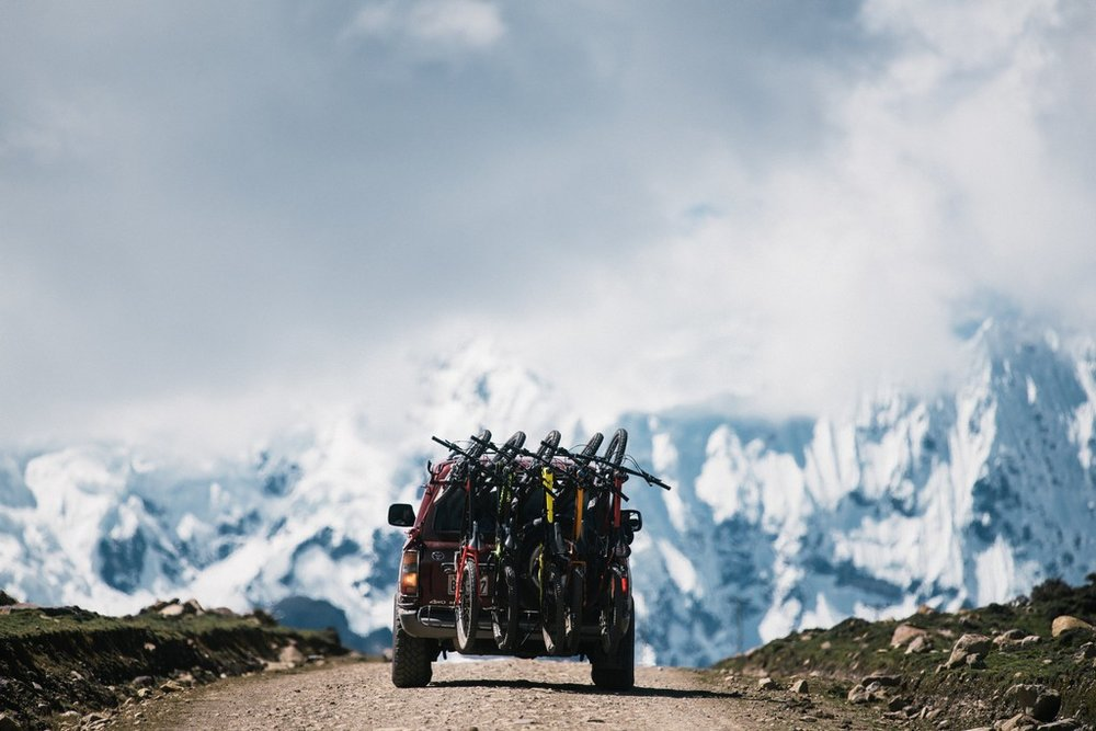 Bike Shuttle with Snow Covered Mountains in Background.jpg