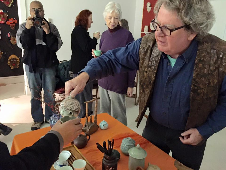 Jimmy Clark serves tea during the Tea Ceremony at the gallery.