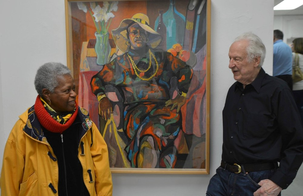 Cynthia, the model in the portrait, chats with Bob at his exhibit.