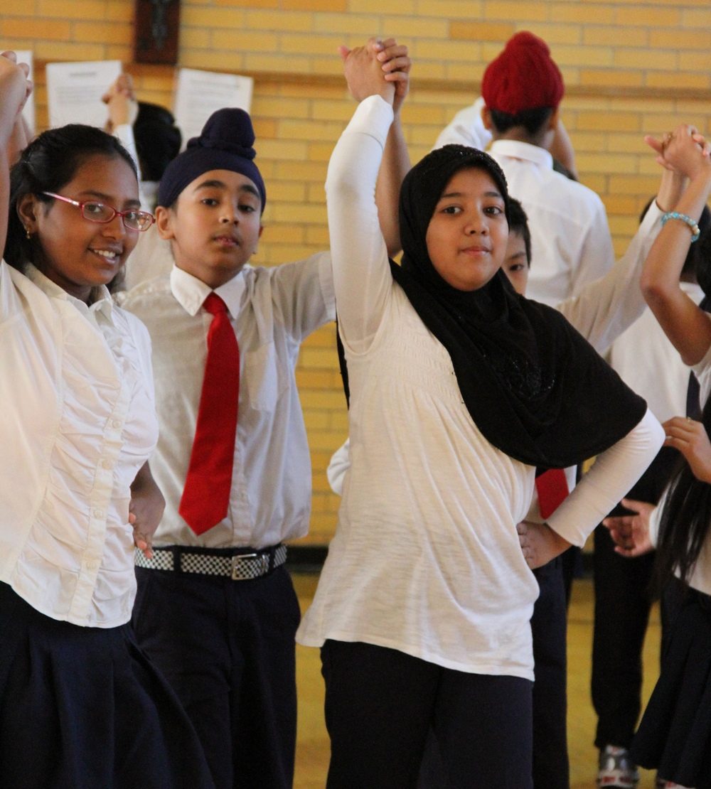 Diverse students learning and dancing together