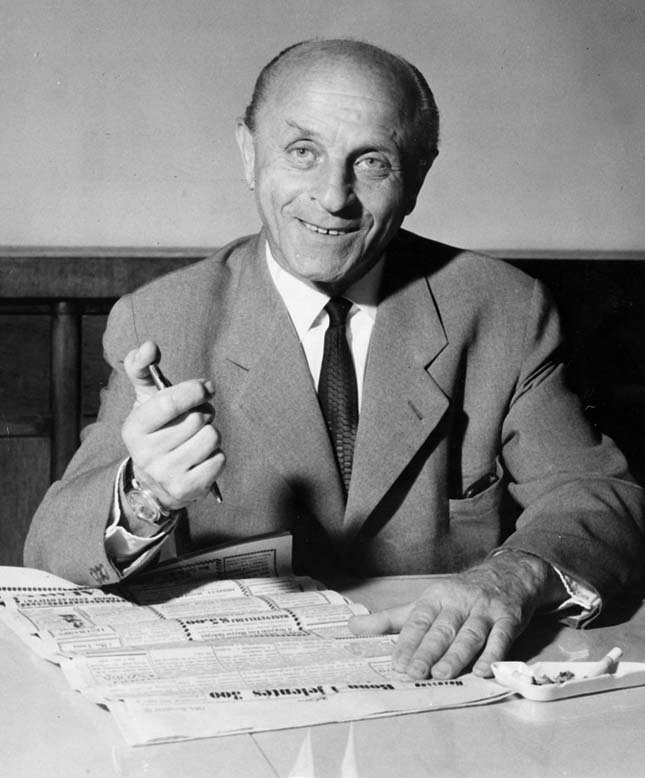 László Bíró holding his patented ballpoint pen.