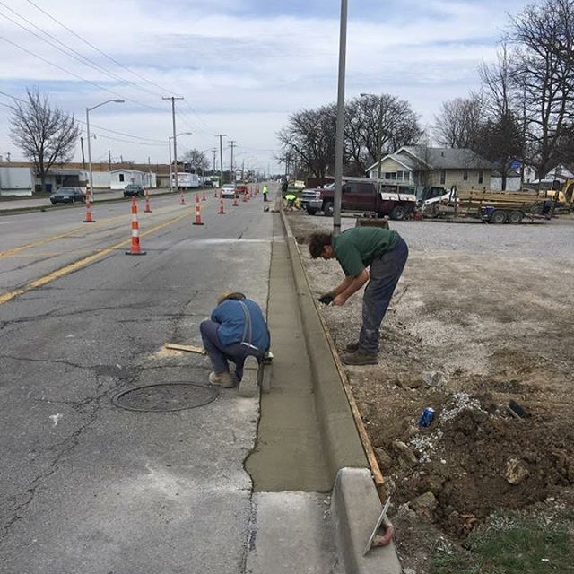 As of today, the only way to get on to the campus is from Ridgewood Drive. Parkhill Avenue AND the access to the parking lot off of Clinton Street is being closed off with the installation of a curb. It's amazing how a little concrete can bring such a huge improvement!