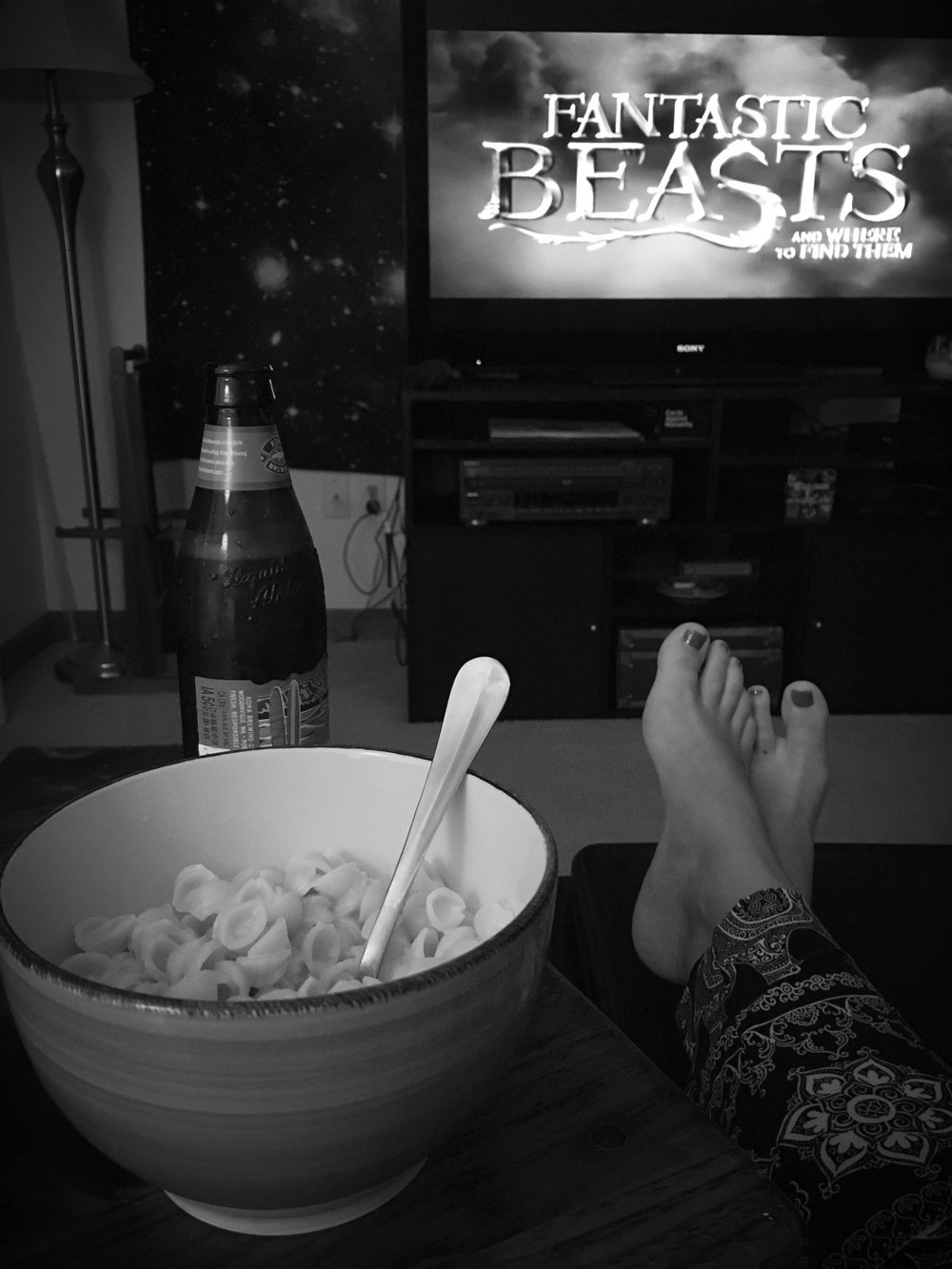 Me, recently enjoying mac and cheese, beer, and Fantastic Beasts.