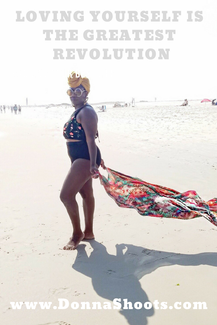 Positive body image. Black girl in bikini on a beach.
