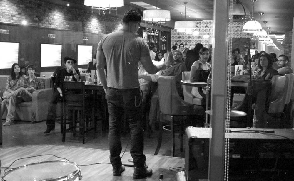 Octavio Quintanilla at a public poetry reading in Illinois.
