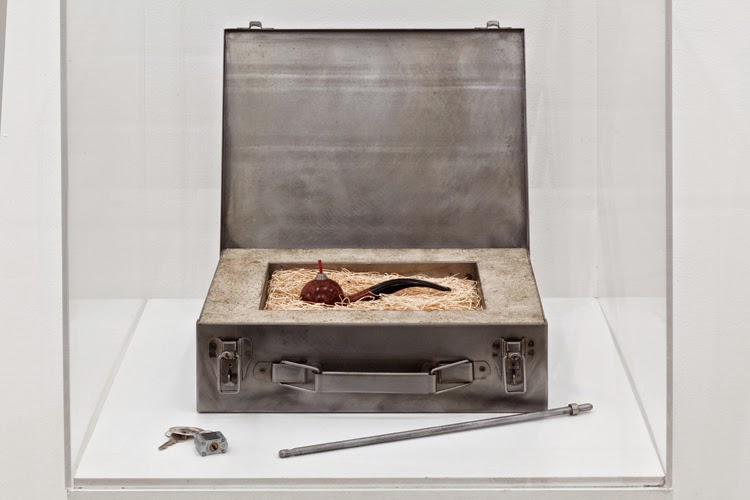 Mel Chin, Elementary Object (For Corsica), 1993, Corsican briarwood, steel, plastic, concrete / vermiculite, excelsior packing material, flannel, paper tag, fuse cord, triple-F blasting powder, 3 1/2 x 12 1/2 x 10 1/4 inches (object in closed case)
