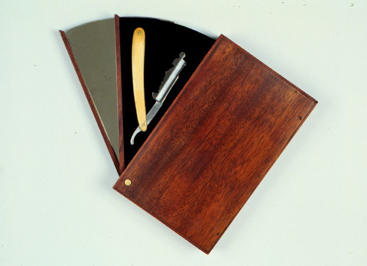 Mel Chin,Rilke's   Razor, Jung's Version  , 1990, Razor, velvet, wood, brass, mirror, 10 x 13 x 2 inches (open), 10 x 6 1/4 x 2 inches (closed)