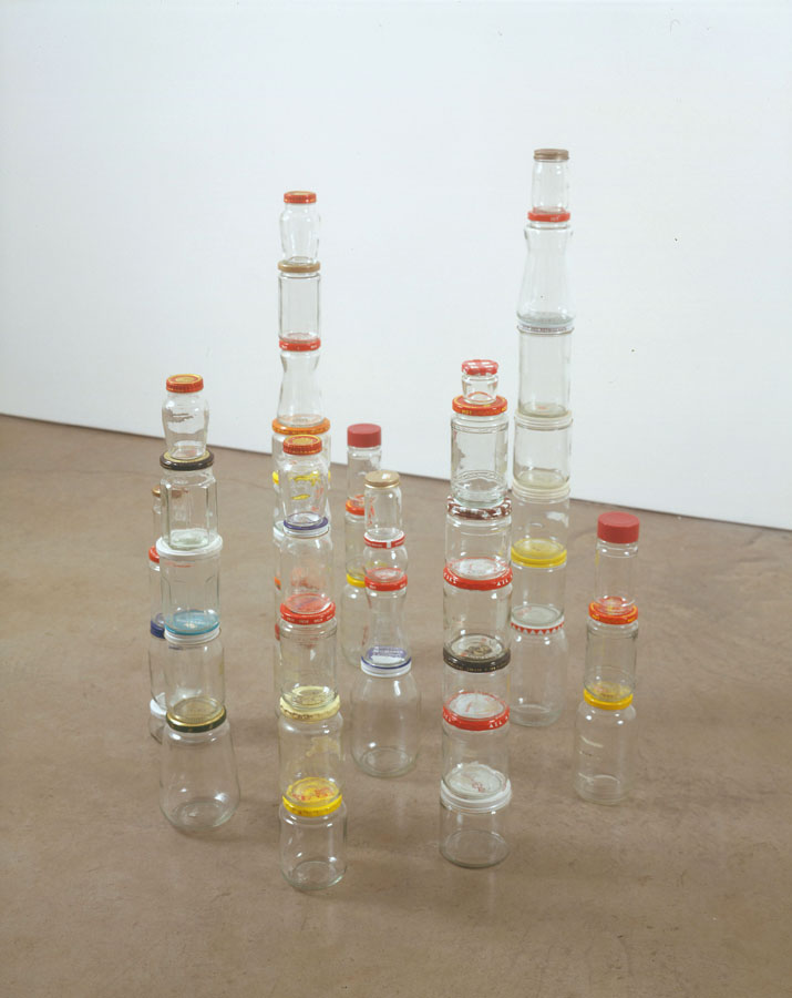 Tony Feher, Untitled, 2004 Nine stacks: forty‐six glass jars and lids of various colors Dimensions vary with installation, approx. 33 x 27 x 17 inches.  Copyright Tony Feher, courtesy The Pace Gallery and D´Amelio Terras, New York