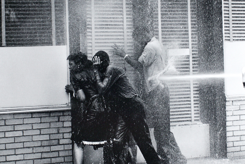 Charles Moore, Firefighters aiming high-pressure water hoses at civil rights demonstrators, Birmingham, Alabama (1963), Gelatin silver print image, 8 1/4 x 12 1/4 inches