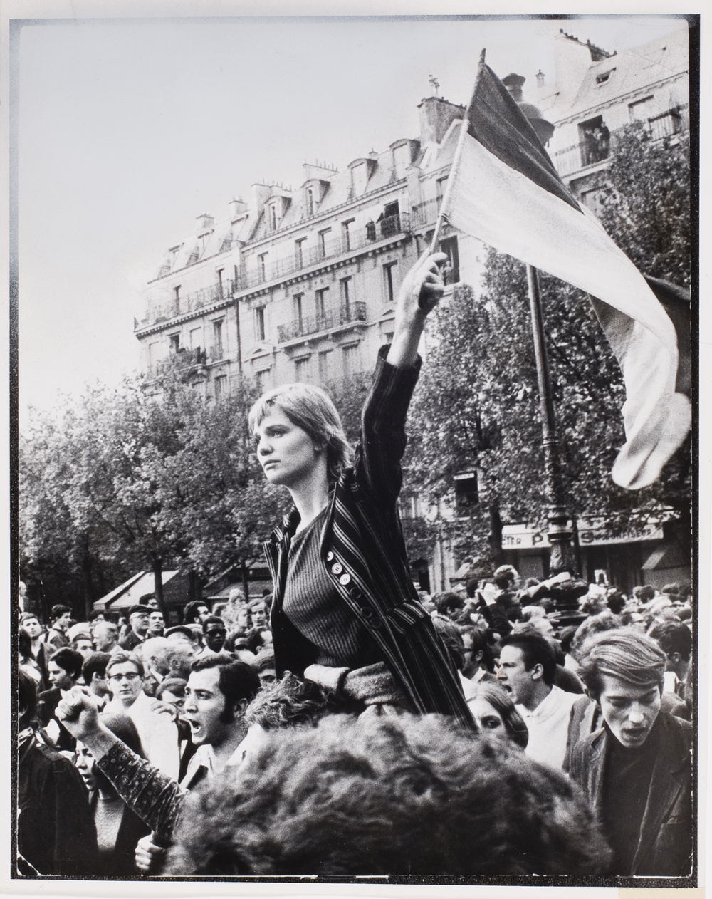 Jean-Pierre Rey, [Girl waving flag in crowd during general strike, Paris], May 1968