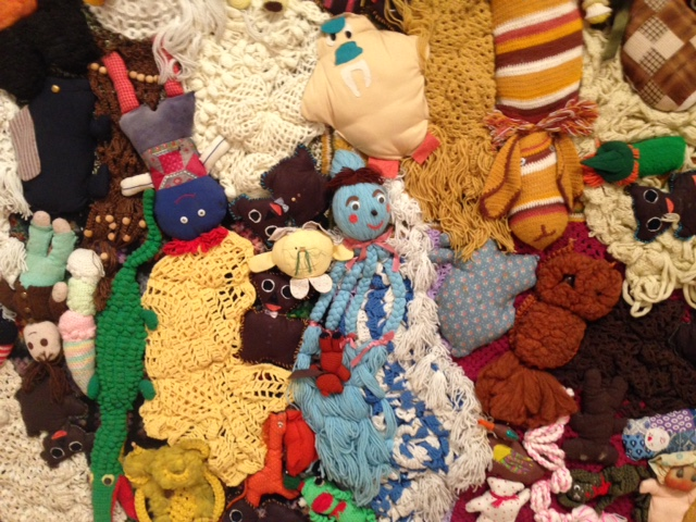 Mike Kelley,  More Love Hours Than Can Ever Be Repaid and The Wages of Sin  (detail), 1987 Stuffed fabric toys and afghans on canvas with dried corn; wax candles on base of wood and metal, Overall 120 3/4 x 151 3/4 x 31 3/4 inches