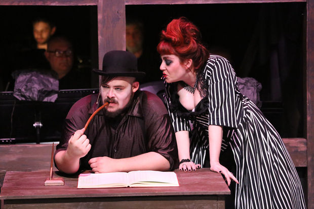 Mr. and Mrs.Peachum (Zachary Allen Farmer and Sarah Porter) in New Line's production
