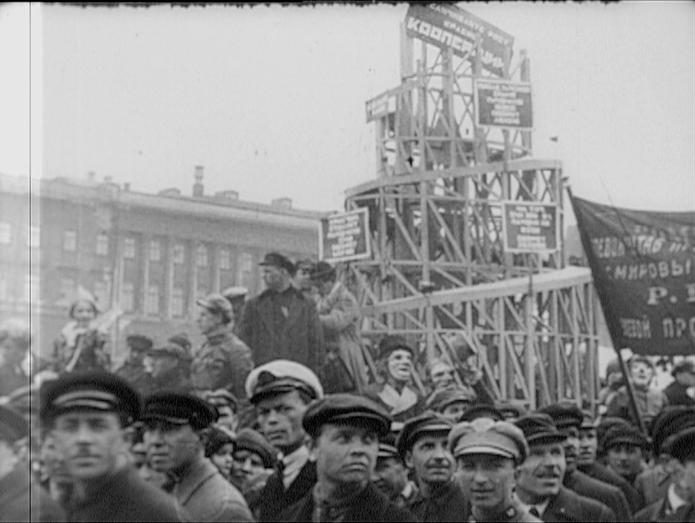 From newsreel footage of a Soviet parade, with a wooden model of Vladimir Tatlin's Monument to the Third International (1919-20)