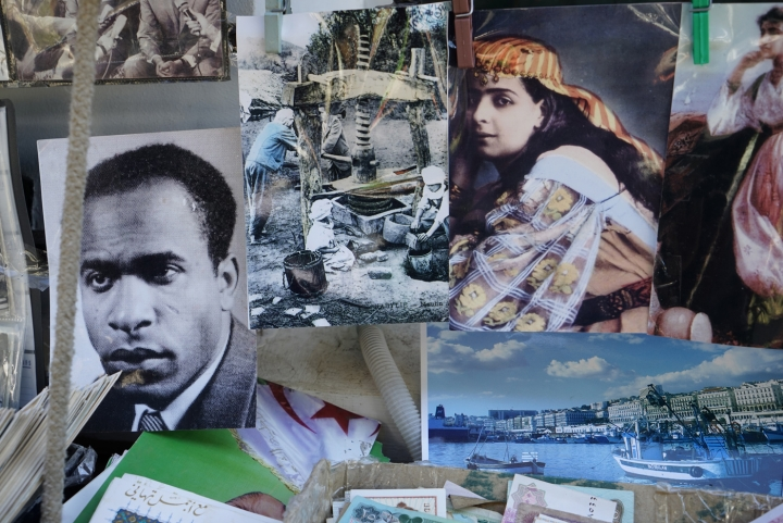 Still from Katia Kameli's short film The Algerian Novel, featuring postcards of Fanon