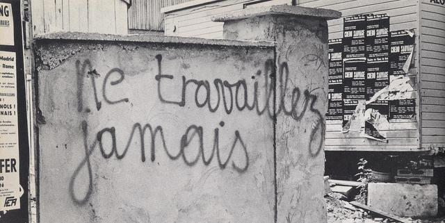 """Never work,"" the Situationist slogan on the walls of Paris, 1968."