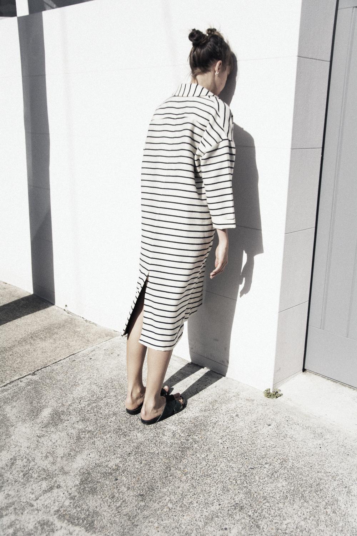 Celeste Tesoriero pinstripe wool coat and slides.