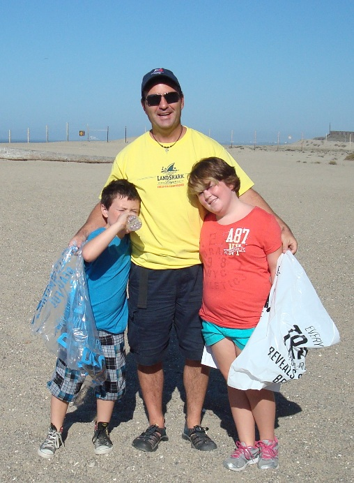 chumash-village-Mugu_Rock_dad_with_kids_trash.jpg