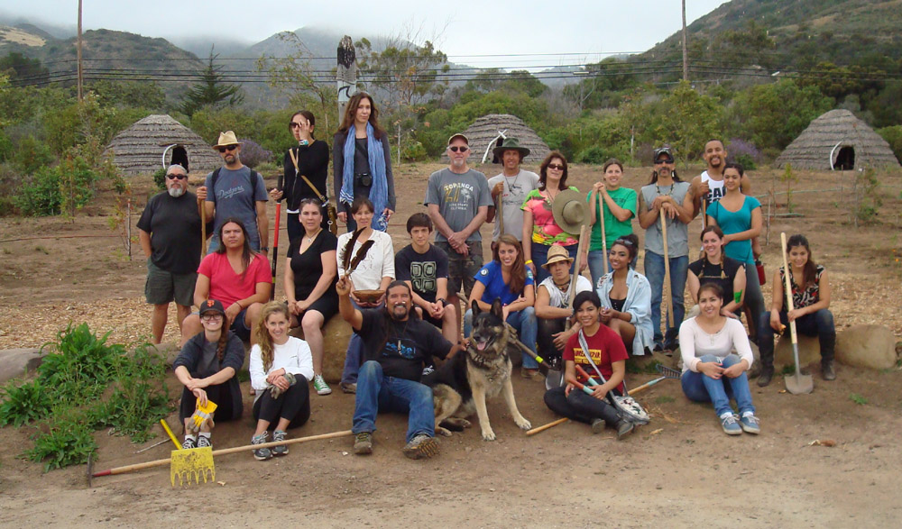 Volunteers helped plant 90 native plants, donated by CalTrout, at the Chumash Village , in a project organized by Breanna Chandler (seated center,  in blue), and Kristen Gangl (seated center row, in black). - June 10, 2012