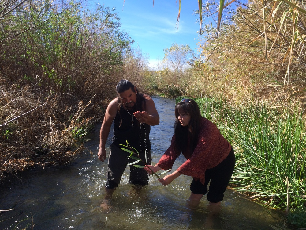Chumash Ceremonial Elder of the Santa Clara River Turtle Clan Mati Waiya and Cultural Resource Director Luhui Isha  making an offering  BEFORE Harvesting WIllow as their peoples have done for countless generations in a Santa Clara River stretch that will be destroyed by the development.