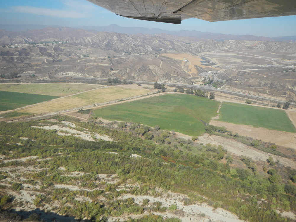 FLYOVER WITH LIGHTHAWK OF THE RIPARIAN FOREST AND OPEN SPACE THAT WOULD BE BULLDOZED OVER AND CONCRETED BY THE PROJECT.