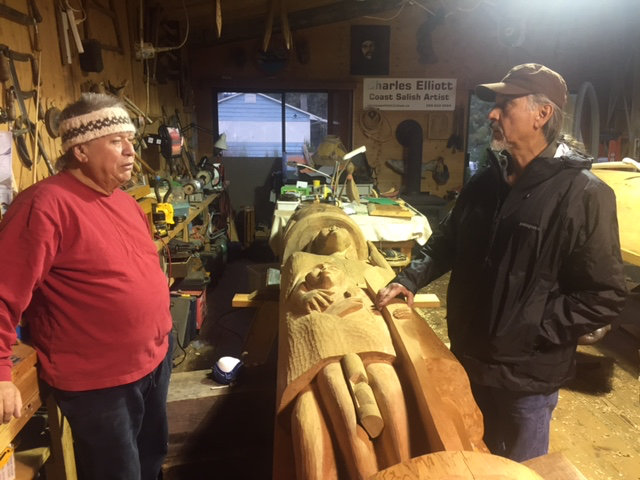 Charles Elliot (Coastal Salish Canoe Carver) & Ray Ward (Chumash Canoe Builder) sharing canoe building techniques.