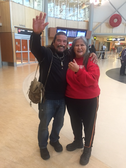 Rose Henry greeting Mati Waiya as he arrives in Canada.
