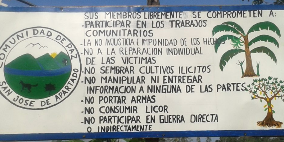 Entry sign stating the principles of San José de Apartado's Peace Community.