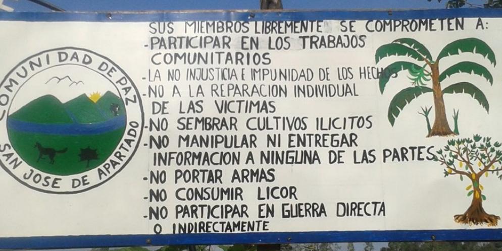 Entry sign stating the principles of San José de Apartado's Peace Community.