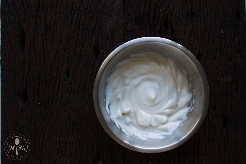 Whip egg whites, salt and vanilla to soft peaks