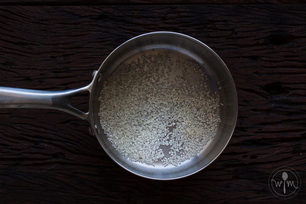 Measure rice into a saucepan