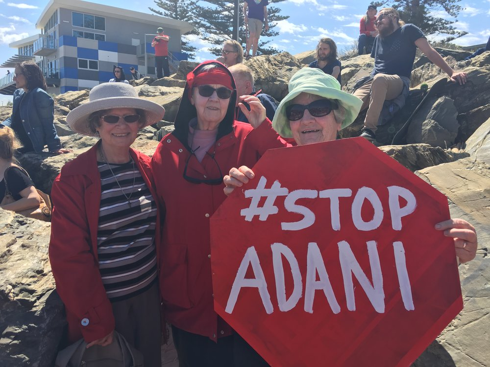 Tess Flaherty rsm, Gabrielle Travers rsm and Claudette Cusack rsm at the Adelaide Adani gathering on the beach at Henley Beach
