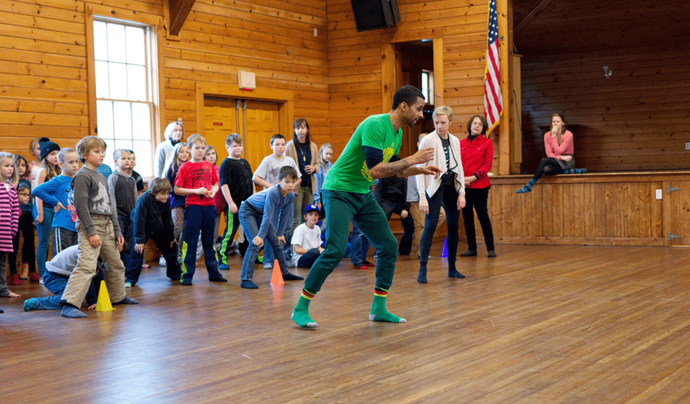 Will Brown leads a brazilian dance workshop with students, photo by brandon ilaw