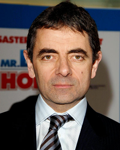 Rowan Atkinson  Ok so this is a hard pitch, just for a second forget Mr Bean and stare into those cold dead eyes. That thousand yard stare could have only developed over years of doing dirty work for Her Majesty.