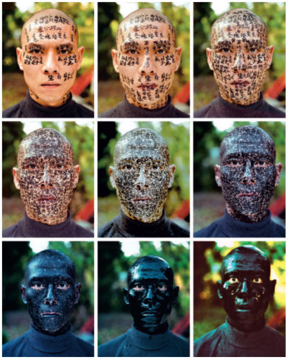 ZANG HUAN,  FAMILY TREE, 2001  - The Artist commissioned a trio of calligraphers to write proverbs, descriptions of family relations and other literary extracts on his face, until his features were entirely obscured by the ink.