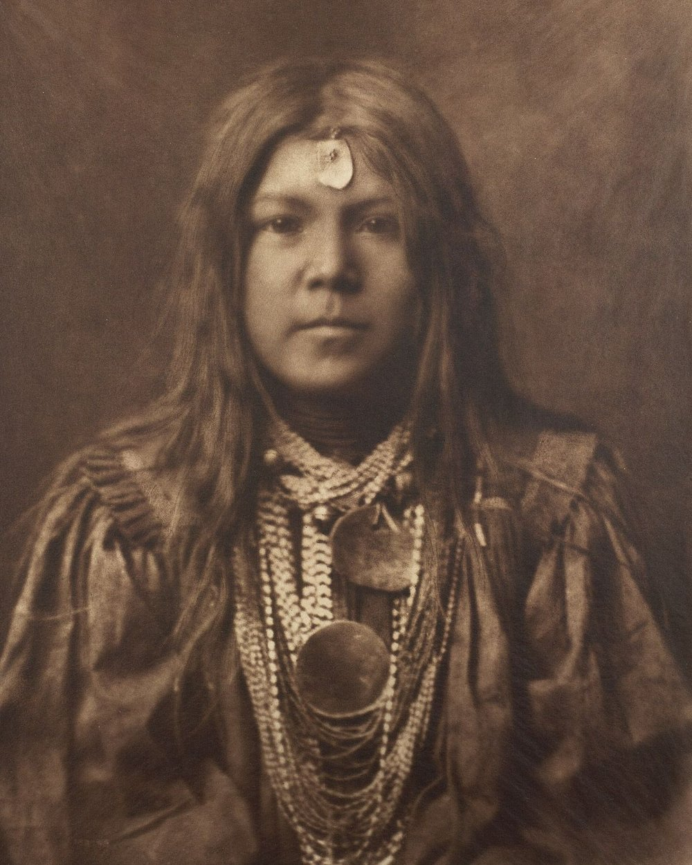 A young member of the Apache tribe,  1910 .   ©EDWARD S. CURTIS/SMITHSONIAN INSTITUTION