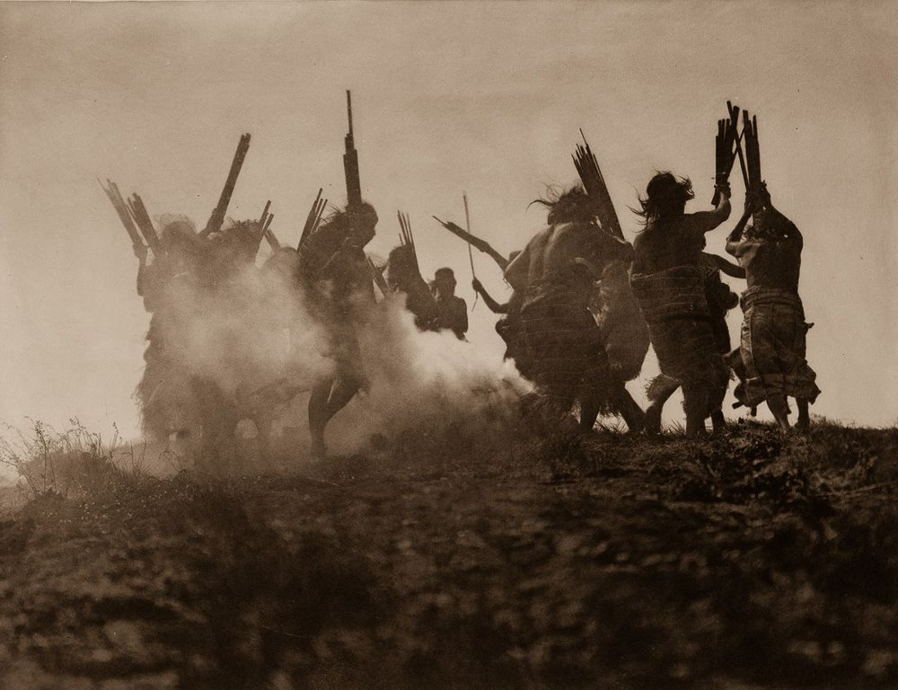 Members of the Qagyuhl tribe dance to restore an eclipsed moon,  c.1910.  ©EDWARD S. CURTIS/SMITHSONIAN INSTITUTION