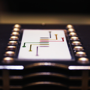 An image of the microfluidic PCR tape designed for use with our portable, lowcost PCR thermocycler for low resource settings.