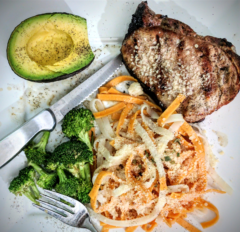 A Tasty Porkchop, Gluten Free Pasta, Steamed Broccoli, and Avocado