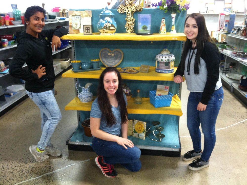 Anagha Velamakanni, Acadia Broscius, and Angelina Lee volunteering at Goodwill