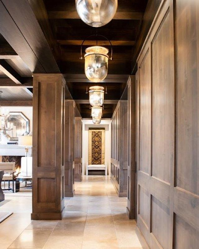@urbanelectricco pendants are a perfect accent to this wood paneled hallway. #woodpaneling #hallways #residentialdesign #denverdesign #pendantlight