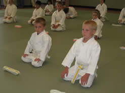 Kneeling kids with new belt