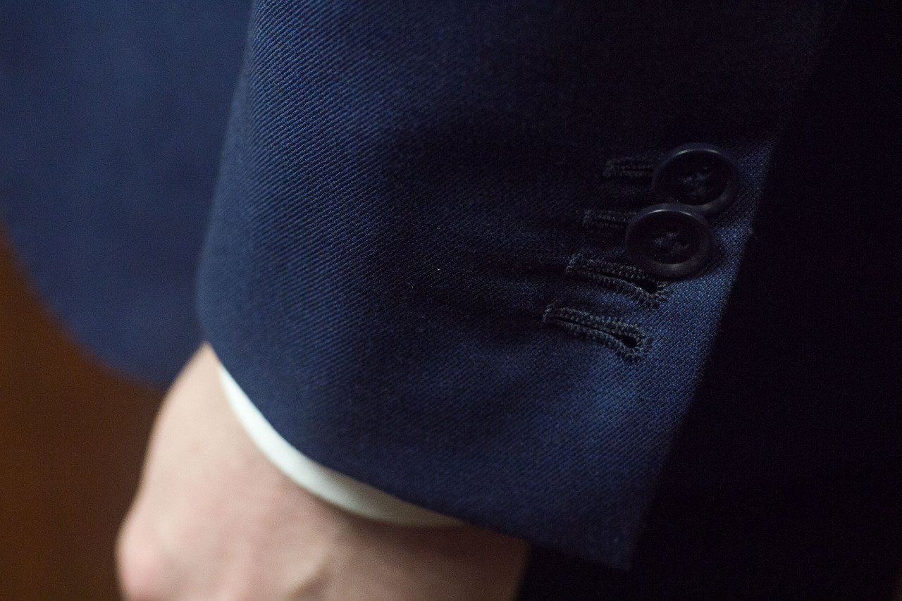 1701 Bespoke hand sewn button holes.