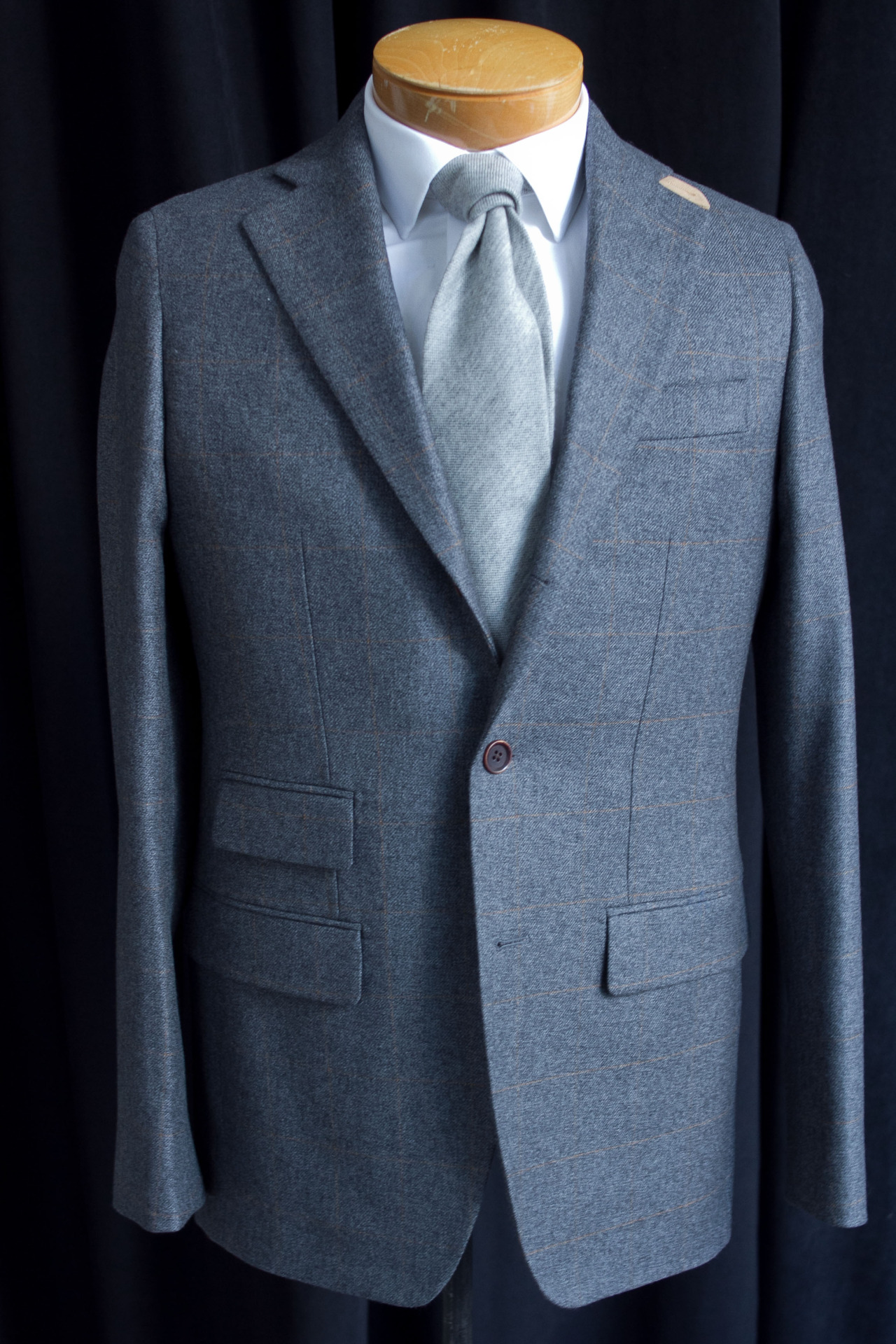 1701 Bespoke gray jacket with rust windowpane and suede throat tab.