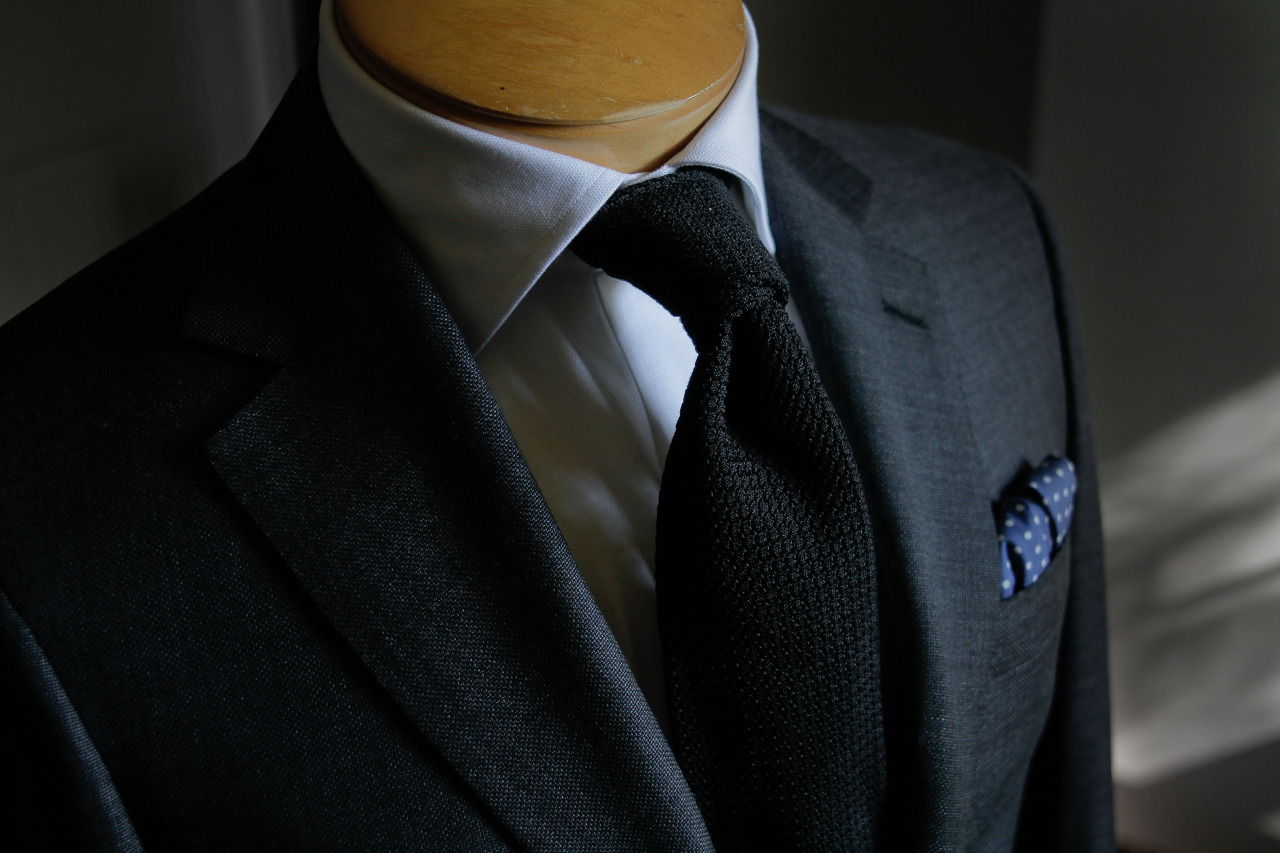 1701 Bespoke handmade, textured charcoal jacket with notch lapel.
