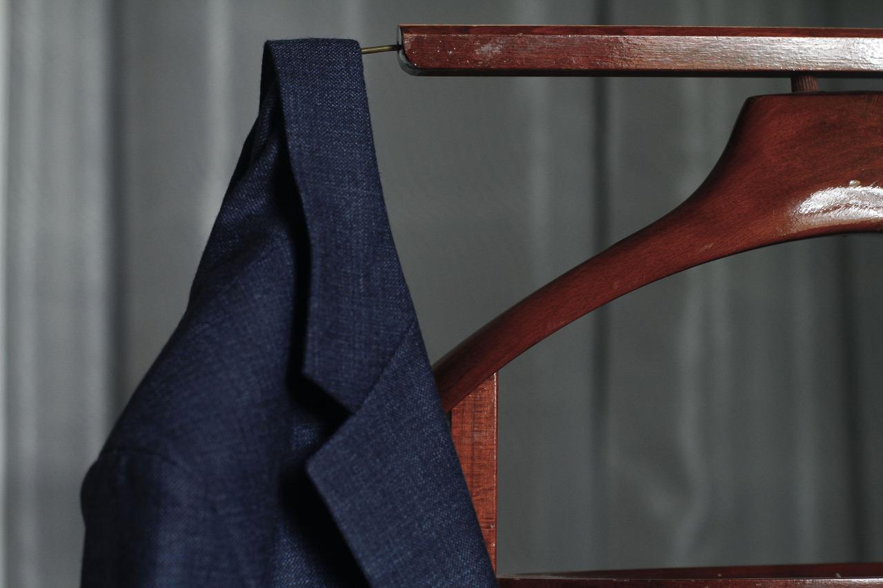 Textured 1701 Bespoke jacket on clothing valet.