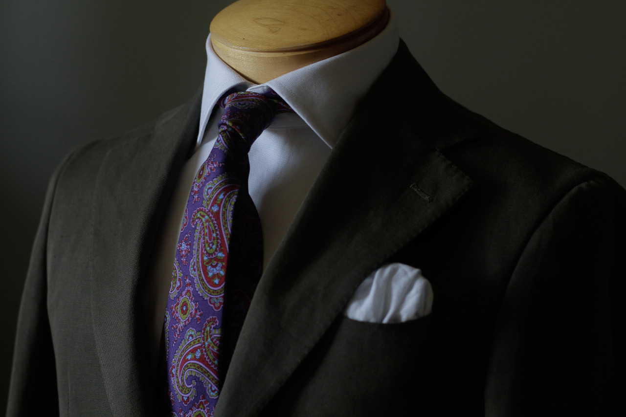 Custom 1701 Bespoke cotton jacket with prominent pick stitching and a wide lapel, along with a handmade tie