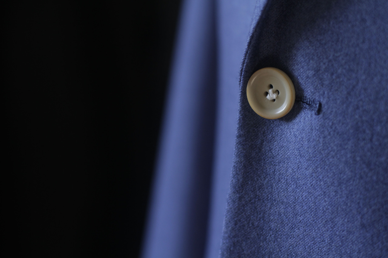 Detail shot of 1701 Bespoke Vitale Barberis Canonico blue flannel 2pc.  Lily stitched cream corozo buttons.