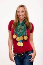 Here Amy Van Dyken is sporting ALL 6 of her Gold Medals